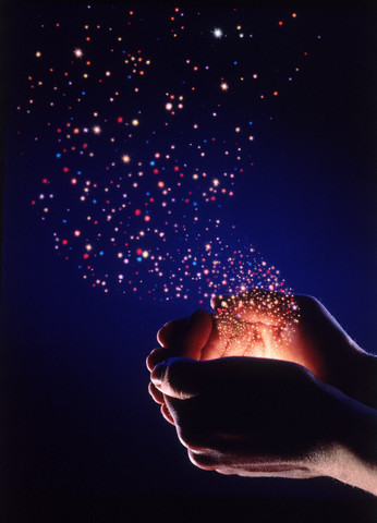 1993 --- Hands Releasing Stars --- Image by © Clayton J. Price/CORBIS